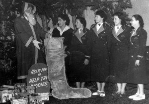 Odeon Toy Appeal cir. 1950s. Santa with staff members. Margret Cooper on the left
