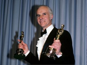 "THE 55TH ANNUAL ACADEMY AWARDS - Backstage Coverage - Airdate: April 11, 1983. (Photo by ABC Photo Archives/ABC via Getty Images) BILLY WILLIAMS, WINNER BEST CINEMATOGRAPHY FOR ""GANDHI"", HOLDING OSCAR STATUETTE OF CO-WINNER RONNIE TAYLOR"