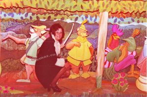 Staff member Pamela Jones inside one of the fully animated hand painted displays in the circle lounge